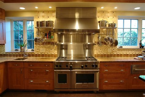 kitchen with stainless steel backsplash how to make the most of stainless steel backsplashes