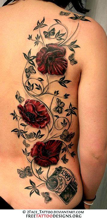 rose tattoo with vines vine on back