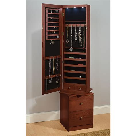 rotating jewelry armoire the swiveling jewelry and accessories armoire hammacher