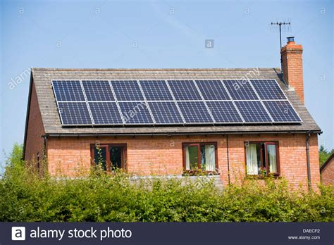 solar panels on roof solar panels on roof of modern detached house in rural