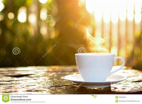Hot Coffee In The Cup On Old Wood Table With Blur Nature Background Stock Photo   Image: 50363203
