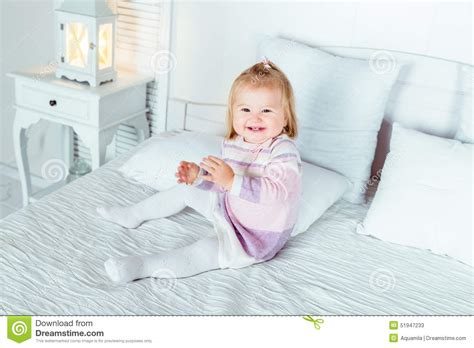 big girl bed funny and cute blond little laughing girl playing on bed