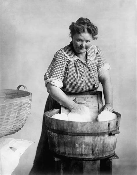 laundry in bathtub woman doing laundry in wooden tub photograph by everett