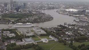 thames barrier weight 47 800 tonne cruise ship squeezes through the thames