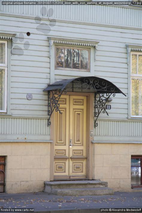 door with iron awning at august weizenbergi 12 kadriorg