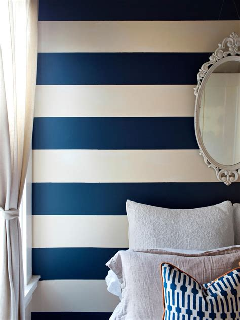 white and navy blue striped wall eclectic bedroom photos hgtv