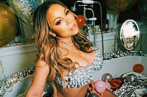 mariah carey in bathtub mariah carey flaunts extreme cleavage in studded bra in bathtub snap celebrity news