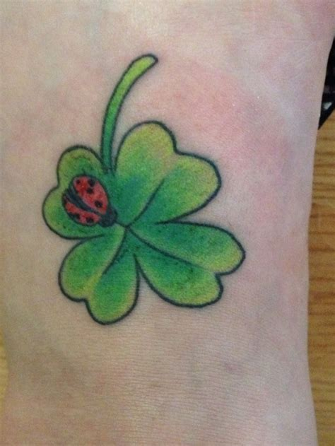 four leaf clover tattoo my new four leaf clover with a ladybug tattoos