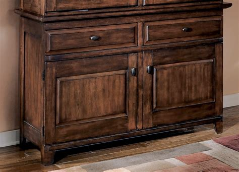 larchmont burnished dark brown dining room buffet d442 80 larchmont buffet from ashley d442 80 coleman furniture