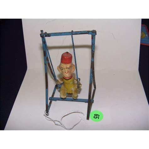 swinging monkey toy very old child s swinging monkey toy on metal swing frame