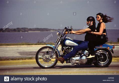Daytona Harley Black riders on a harley davidson motorcycle during the daytona bike week stock photo royalty free