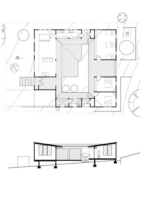 small vacation house plans small vacation home wraps around large private courtyard