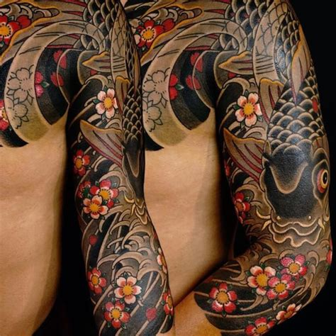 tattoo oriental irezumi traditional japanese tattoos swirling with cherry blossoms