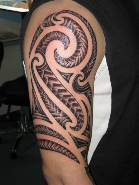 tribal tattoo around arm 30 best tribal designs for mens arm