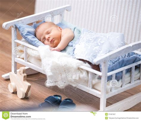 Small Mattress For Baby by Newborn Baby In A Small Bed Royalty Free Stock Photography
