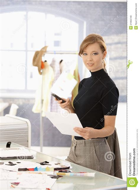 attractive fashion designer working  desk stock photo
