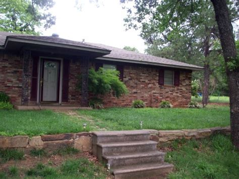 renovator s block 80 s ranch house needs new landscaping and a lift