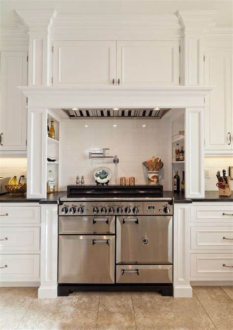 hood cabinet kitchen cabinets above stove custom elegant pot filler faucet in kitchen traditional with