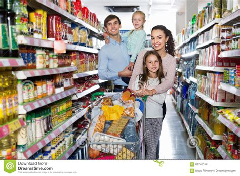 Time To Actually Buy Groceries by Cheerful Customers With Children Buying Food In