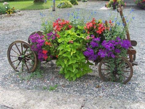 Wagon Flower Planter by Wagon Planter Garden Wheelbarrows Wagons Wheels