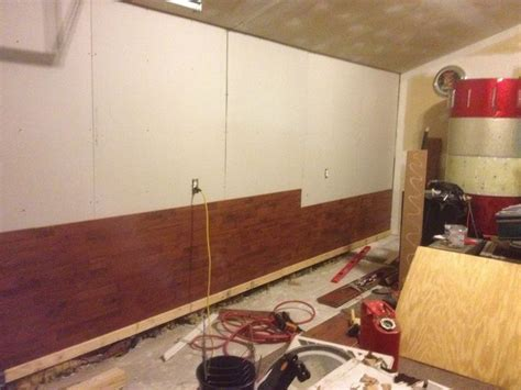 using laminate flooring as a wall covering the wolven house project wolven house project