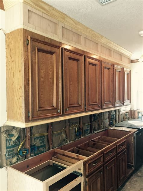 Adding An Island To An Existing Kitchen how to make ugly cabinets look great designed