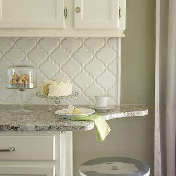 Creamy white kitchen cabinets with bianco antico granite countertops