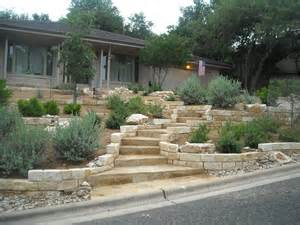 xeriscape front yard with limestone retaining walls and a grand staircase using oklahoma