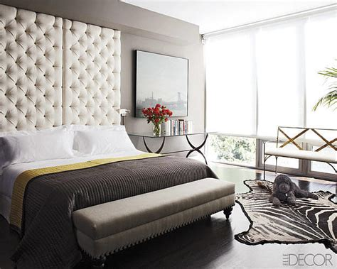 Bedroom With Tufted Headboard by A Floor To Ceiling Tufted Headboard Looks Almost Subdued