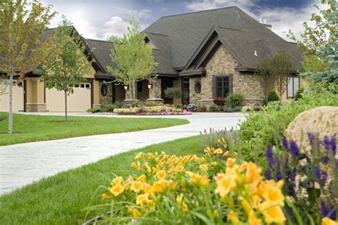 house plans with circular driveway circular driveway with l shaped house stone work on house home ideas pinterest