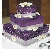 The Cake Is Covered In A Purple Fondant Decorated With Brushed