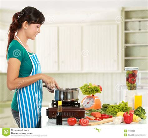 in the kitchen cooking in the kitchen royalty free stock images