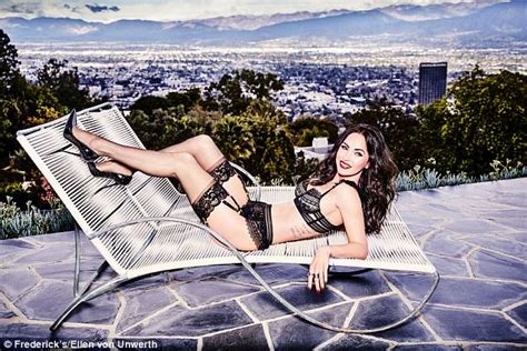 lorena sizzles as she poses on the bed wearing a hot black megan fox poses in frederick s of hollywood lingerie pics