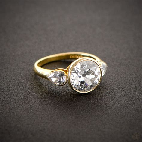 vintage style engagement ring gold set pear and
