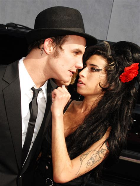 Bloodied And Bruised Winehouse Stands By Husband Who Saved by Winehouse A Tumultuous Ew
