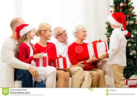 smiling family with gifts at home stock photo image