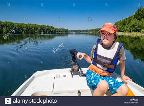 electric boat holidays boy driving boat stock photos boy driving boat stock