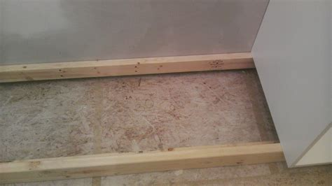 how to level kitchen base cabinets once upon an acre installing the kitchen base cabinets