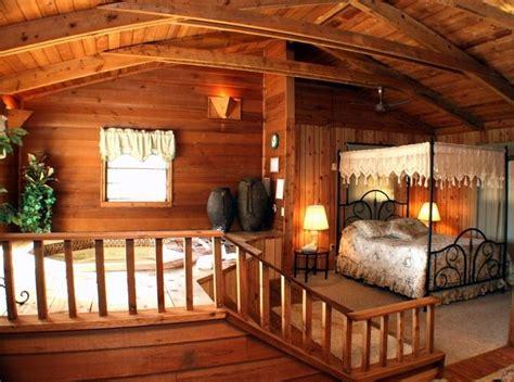 tub in bedroom in log cabin win home