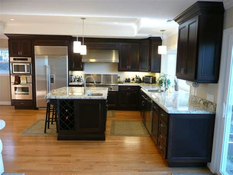 espresso kitchen cabinets with white granite kitchen with espresso stained cherry cabinets granite