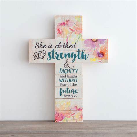 she is clothed with strength dignity wooden cross