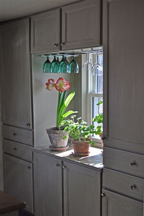 budget friendly cabinet makeover the diy village single wide mobile home remodel budget makeover kitchen
