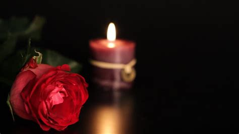candele rosa and candle on black background stock footage