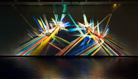 artistic lighting prismatic graffiti bending light into a spectrum of wall
