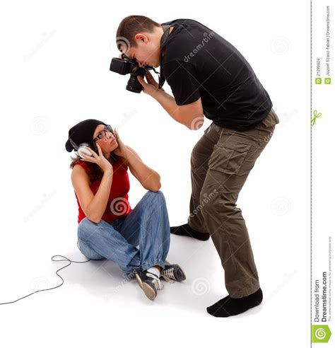 Taking A by Photographer Taking Picture Of Sitting Model Stock Photo