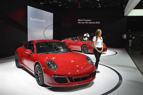 carmine red porsche 911 carrera gts and 2015 cayenne gts paint la in