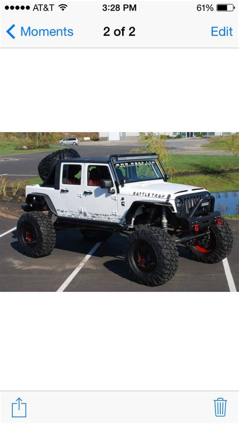 4 door jeep wrangler jacked up jacked up jeep wrangler jk white lifted light bar flat top