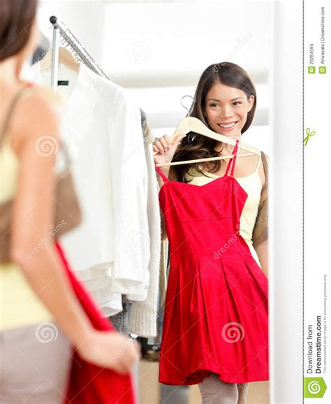 shopper trying clothing dress shopping stock photo