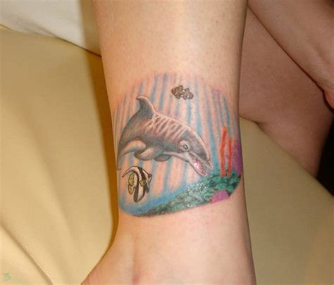simple tattoo colored simple tiny colored dolphin tattoo on ankle tattooimages biz