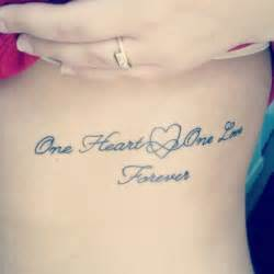 my first tattoo i love it one heart one love forever
